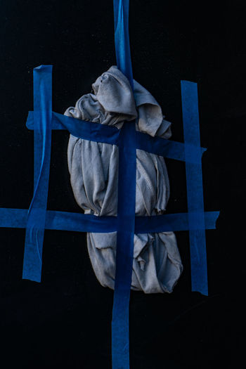 No People Blue Close-up Black Background Human Representation Art And Craft Metal Creativity Sculpture Representation Indoors  Night Cross Studio Shot The Past Tied Up Architecture Male Likeness Statue Fence