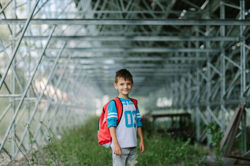Happy student looking forward to his first day at school. Alone City First Day Of School Morning Preschool September Student Back To School Boy Child Childhood Day Education Kid One Person Outside Primary Pupil School Schoolbag Schoolboy Schoolchild Urban Walking Way