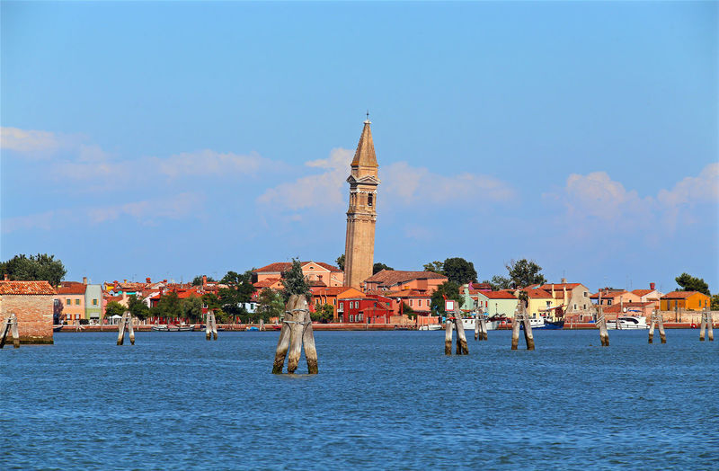 Bell tower of Burano an island in the Venetian Lagoon in northern Italy Church Cityscape Panorama Travel Venetian Venezia Adriatic Sea Bell Tower Briccola Briccole Bricole Burano From Boat Island Isle Italy Landscape Sea Tourism Travel Destinations Venice Province