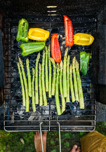Directly above shot of vegetables on barbecue grill