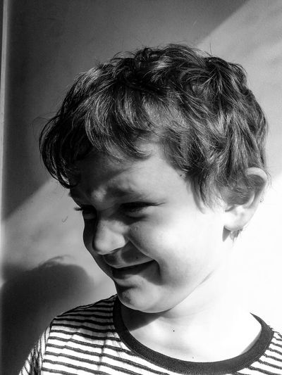 #NotYourCliche Headshot One Person Childhood Child People Eyes Closed  Human Face Portrait Happiness Real People Close-up Indoors  Human Body Part Children Only Smiling Adult Squint Day Sunny Son Sun In Eyes Shiny Cheerful Happiness Elementary Age Black And White Friday This Is Masculinity