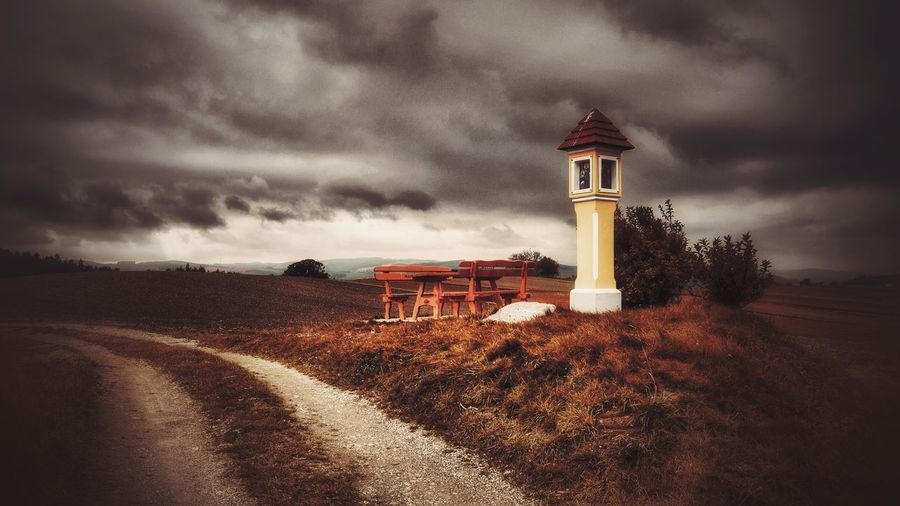 architecture Built Structure Nature Field No People Outdoors Sky Cloud - Sky Landscape Beauty In Nature Rural Scene Mystical Atmosphere A Photo Like A Painting Melancholic Landscapes Austria Field Storm Cloud Capture The Moment Tranquil Scene Vienna Alps Landscape_photography Resting Place