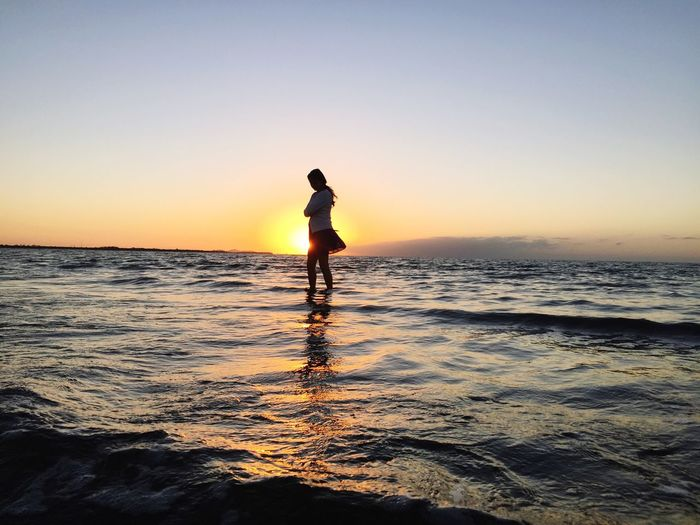 Beautiful Horizon Over Water Sunset Water Sea Silhouette Clear Sky Vacations Scenics Beach Standing Copy Space Leisure Activity Full Length Orange Color Waterfront Tranquil Scene Beauty In Nature Idyllic Nature Wave Girl Amazing Angel First Eyeem Photo