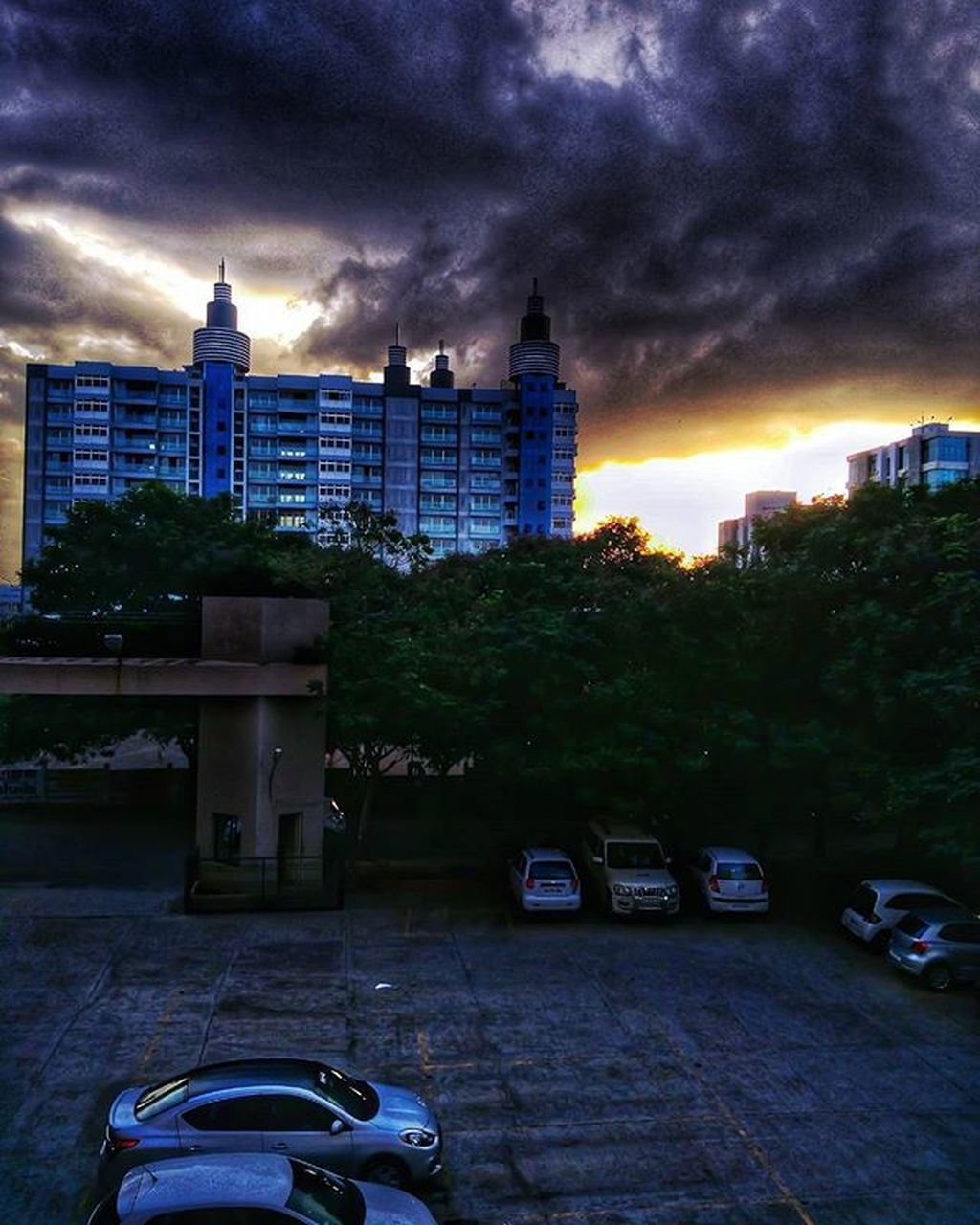 architecture, built structure, building exterior, cloud - sky, city, sky, skyscraper, modern, cityscape, outdoors, sunset, no people, illuminated, tree, urban skyline, day, nature