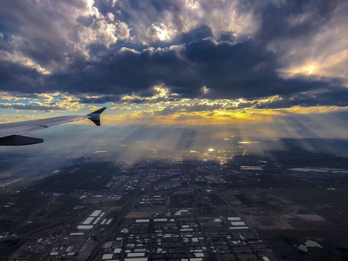Cloud - Sky Sky Water Reflection Nature Beauty In Nature Scenics - Nature No People Outdoors Tranquility Transportation City Tranquil Scene Sunset Flying Dramatic Sky Air Vehicle Cityscape