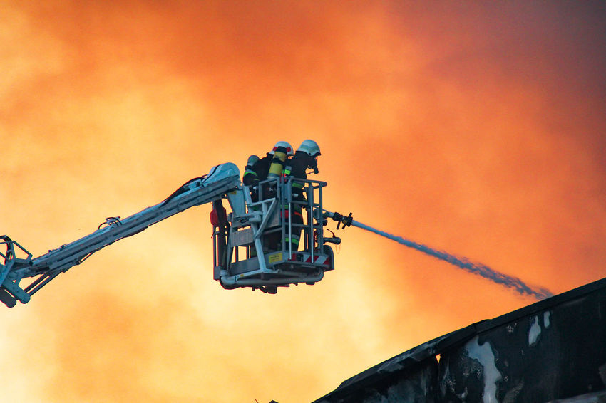 Fireworks Architecture Day Drilling Rig Emergency Services Emergency Services Occupation Fire Firefighters Firefighters In Action Low Angle View No People Orange Color Outdoors Sky Transportation