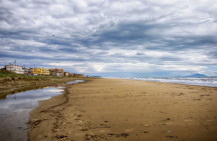 Beach Beauty In Nature Blue Built Structure Cloud Cloud - Sky Cloudy Coastline Colors Day Horizon Over Water Idyllic Nature No People Outdoors Overcast Scenics Sea See Shore Sky Tranquil Scene Tranquility Water Weather