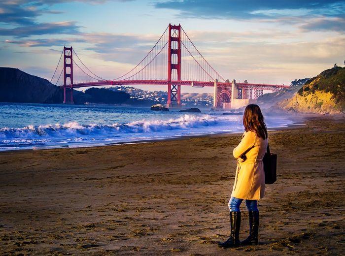 Woman looking at golden gate bridge