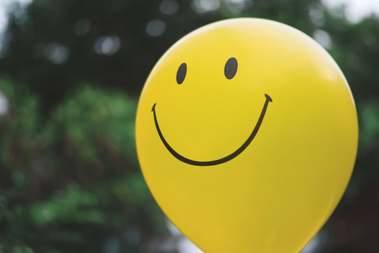 Yellow smile balloon. Yellow Focus On Foreground Balloon No People Smiling Circle Outdoors Day Celebration Face Close-up Smile Smiley Face Nature Green Blink Happy Happiness Excited Emotion Single Object Anthropomorphic Smiley Face