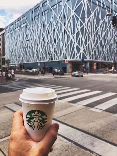 Starbucks in Vienna Human Hand City Hand Human Body Part Architecture Real People Holding Personal Perspective One Person Day Built Structure Street Lifestyles Cup Drink Food And Drink Close-up Incidental People Transportation Finger