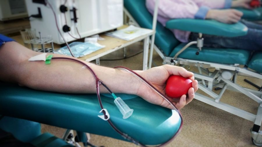 Cropped Image Of Man Donating Blood At Hospital