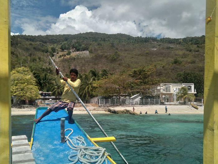 Boatman Cebu Whale Watching Philippines Sea Wanderlust Wandering Boatman Fisherman Blue Yellow Boat Tree Water Blue Sky
