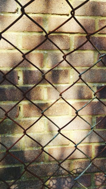 Chainlink Fence Full Frame Metal Backgrounds Safety Pattern Security Protection Seamless Pattern Day Outdoors Crisscross No People Textured  Close-up Nature Sky Brickwall Fenced In Fenced Out Fenced Off In And Out