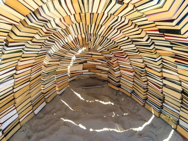 Sculptures by the Sea 2016: Book Sculpture Reams Literature Pile Stacked Books Pages Sculptures By The Sea Book Sculpture ArtWork Arts Festivals Sculptures Western Australia Cottesloe Beach March 12,2016 Hardback Hardback Books Abstract Art Abstract Shelter Igloo Arts And Entertainment Culture Arts Sand Beach