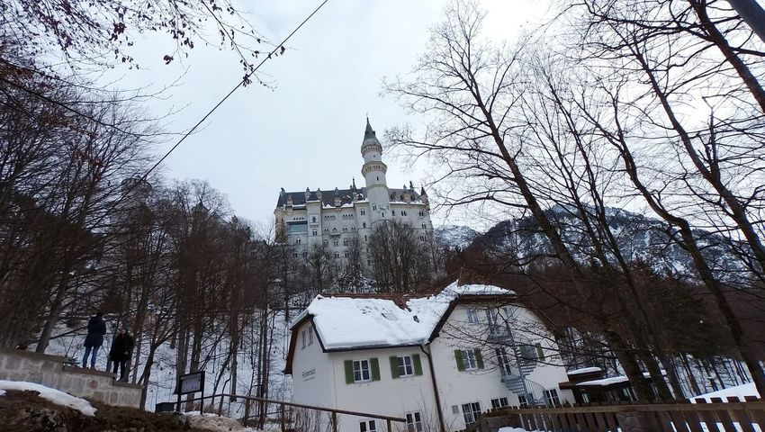 Schloss Neuschwanstein, Germany 2015. It was my second time to see real snow in my entire life, but the FIRST time to see snow piling on the rooooof! I couldn't tell how excited and touched I was at that time lol Thats just so pretty :)