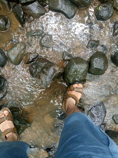 Day Human Foot Low Section Nature Outdoors Person Personal Perspective Rock Rubber Boot Shoe Standing Vacations Water