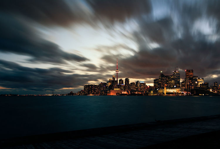 Iconic view of Toronto skyline from Polson Pier. Long exposure, just after a dramatic cloudy sunset. Canada City Cityscape Cloud - Sky CN Tower Dramatic Sky Harbour Lake Night No People Ontario Sky Skyscraper Toronto Urban Skyline First Eyeem Photo Fresh On Market 2017