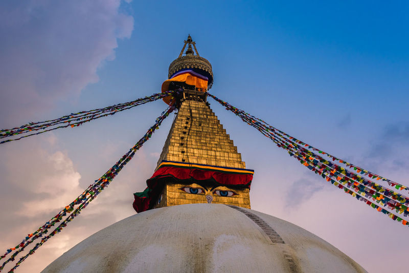 Boudhanath Stupa World Heritage Site By UNESCO Architecture Belief Building Building Exterior Built Structure Cloud - Sky Day Low Angle View Nature No People Place Of Worship Religion Sky Spire  Spirituality Tall - High Tourism Travel Travel Destinations