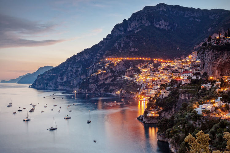 Positano profile view, with the street lights on. Amalfi Coast Architecture Beauty In Nature Cityscape Coast Cold Temperature Day Landscape Mountain Natural Light Nature No People Outdoors Positano Scenics Seascape Sky Snow Sunset Sunset Silhouettes Sunset_collection Water