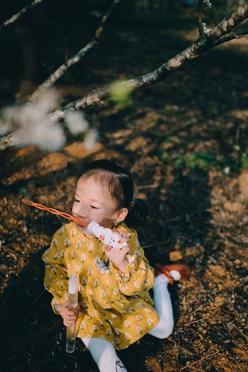 Cute girl at plum blossoms garden
