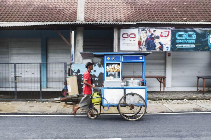 kaki lima / five legs spotted in canggu bali - https://www.instagram.com/five_legs/ Bali Balinese Life INDONESIA Man Walking Street Vendor Bakso Canggu Five Legs Food Stall Fujifilm_xseries Kakilima One Person Red Shirt Southeast Asia Street Food Street Photography Strideby