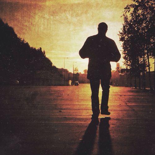 Man walking towards the sunset