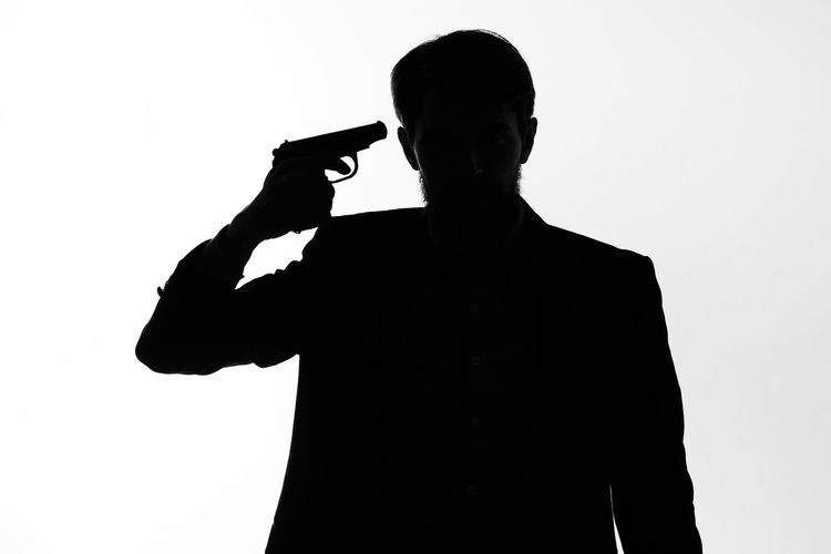 Silhouette man standing against white background