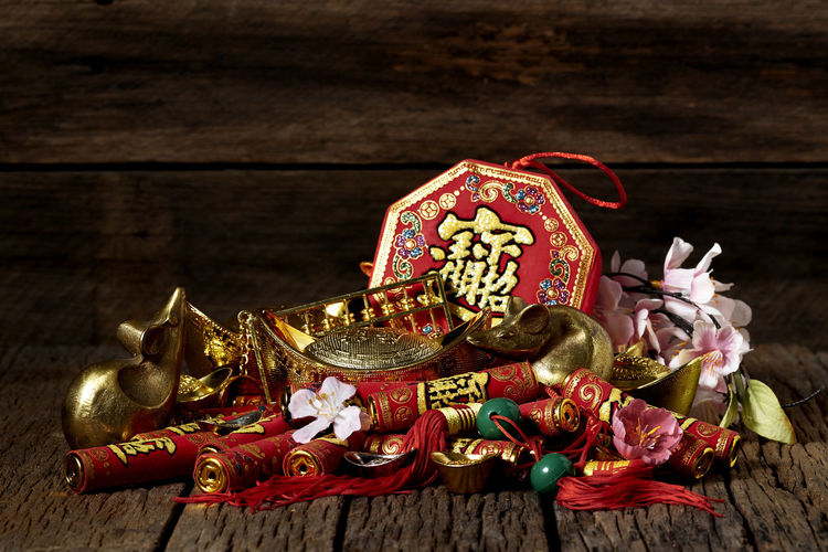 Chinese New Year Lunar New Year Good Luck Decoration Festive Wooden Table Luck Mascot Flat Lay Celebration Craft Firecrackers Ornament Gold China 2020 2019 Pig Minimal Sales Envelope Celebrations Flowers Lucky Tradition Symbol Red Fu Background Festival Spring Holiday Traditional Gold Culture Oriental Fortune Asian  ASIA Packet Plum Blossom Design Celebrate Greeting Prosperity Auspicious Money Happiness Firecracker Ingot Indoors  Still Life Wood - Material Gold Colored No People High Angle View Close-up Art And Craft Focus On Foreground Metal Christmas Decoration Religion Belief Christmas Ornament