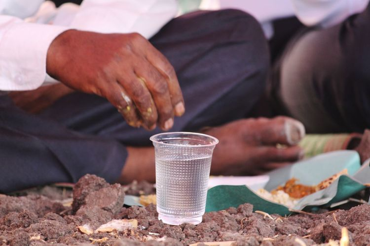 eating food in field Water EyeEm Serving Eyeemindia Human Body Part Capture The Moment Eyeem India This Is My Skin In Field EyeEm Selects Human Hand Men Sitting Low Section Politics And Government Close-up Prepared Food Body Part Hand Finger Toe Knee Index Finger Wrist Beverage