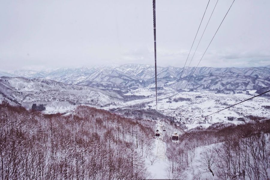 Beauty In Nature Cable Cold Temperature Day Landscape Mountain Nature No People Outdoors Overhead Cable Car Scenics Ski Lift Sky Snow Tree Winter