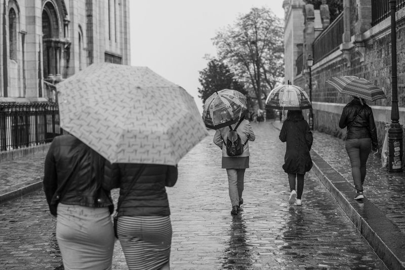 The Street Photographer - 2018 EyeEm Awards Adult Architecture Building Exterior Built Structure City Day Group Of People Men Monsoon Outdoors Rain Rainy Season Real People Rear View Street Umbrella Walking Water Wet Women Human Connection