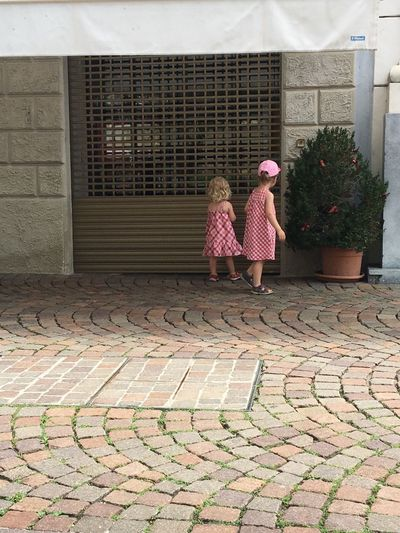 Pink Sisters Young Architecture Building Exterior Built Structure Childhood Day Full Length Girls Girls In Pink Lifestyles Outdoors People Real People Sidewalk Sisters Love Standing Street Streetphotography Togetherness Two People We Wear Pink Lost In The Landscape