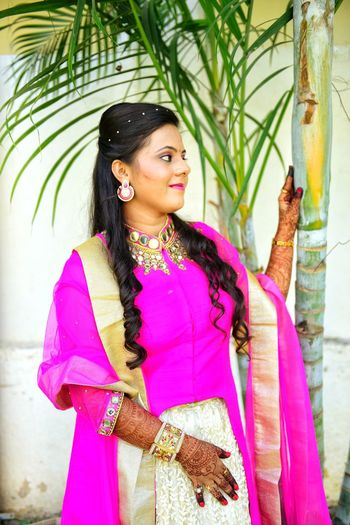 Smiling Bride In Traditional Clothing Looking Away Standing Outdoors