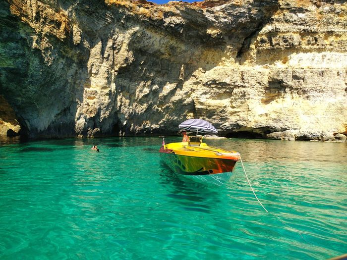 Boat on the water Sea Outdoors Boat Sun Rock Rock Formation Malta Comino