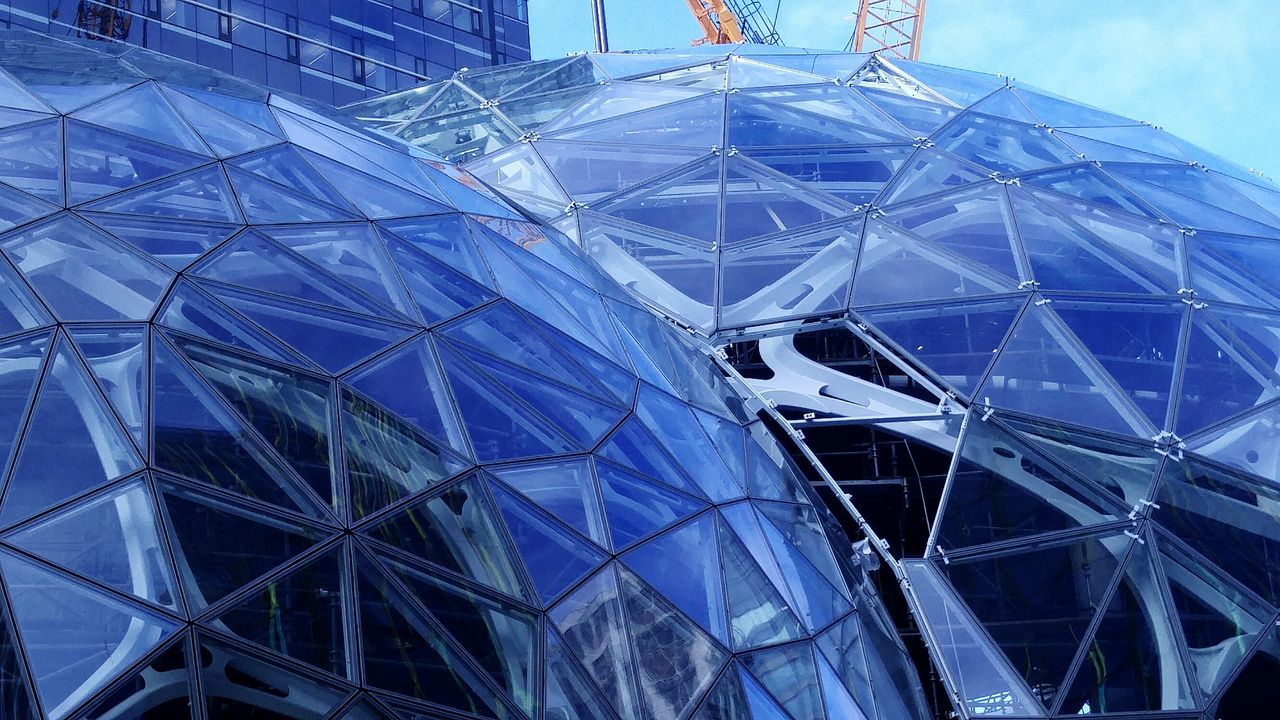 glass - material, architecture, geometric shape, built structure, modern, blue, reflection, building exterior, low angle view, day, futuristic, no people, outdoors, close-up, sky
