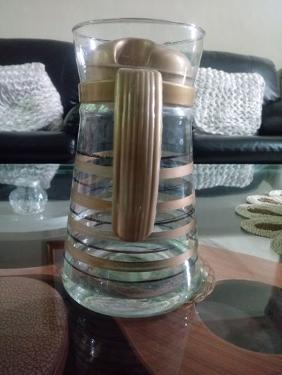 High angle view of glass jar on table at restaurant