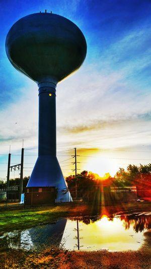 Pristine Watertower Puddle Puddleography Puddle Reflections Sunrays Sunrise Daytime Morning Morning Sun Morning Light Morning Sky Skyporn Sky And Clouds Cloud - Sky Sky Sky And City Sky Porn The Week On EyeEm
