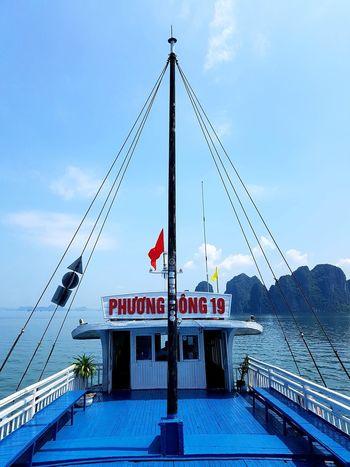 a blue ship on the sea EyeEm Gallery Water Blue Flag Sky Ship Passenger Ship Sailing Ship