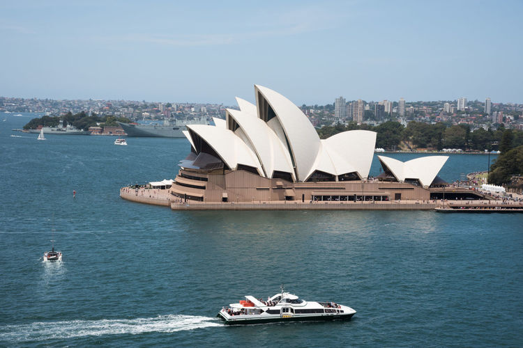 Sydney,NSW,Australia-November 20,2016: Elevated view over the Sydney Opera House at Bennelong Point in Sydney, Australia 20th Century Architecture Australia Cityscape Ferry Harbour Roof Sydney Cove Sydney Opera House Tourist Attraction  Transportation Arts Culture And Entertainment Bennelong Point Boat Building Exterior Circular Quay Elevated View Expressionist Landmark Motion Nautical Vessel Sydney Travel Destinations Wake Water