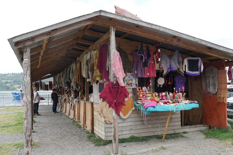Clothes drying at market stall against sky
