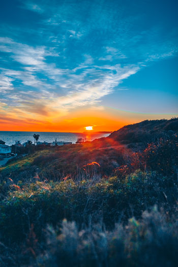 Malibu Sky Nature No People Outdoors Scenics - Nature Sunset Beauty In Nature Cloud - Sky Tranquil Scene Tranquility Land Orange Color Plant Environment Non-urban Scene Water Sea Idyllic Grass Landscape
