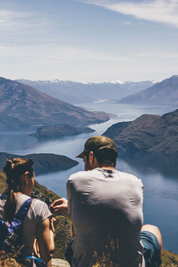 The view west from Roy's Peak. Couple Hiking Reflection Wanaka Beauty In Nature Blue Blue Sky Day Hikingadventures Lake Lake Wanaka Landscape Leisure Activity Lifestyles Mountain Mountain Range Nature New Zealand Outdoors People Real People Summer Two People Wanaka Tree Water