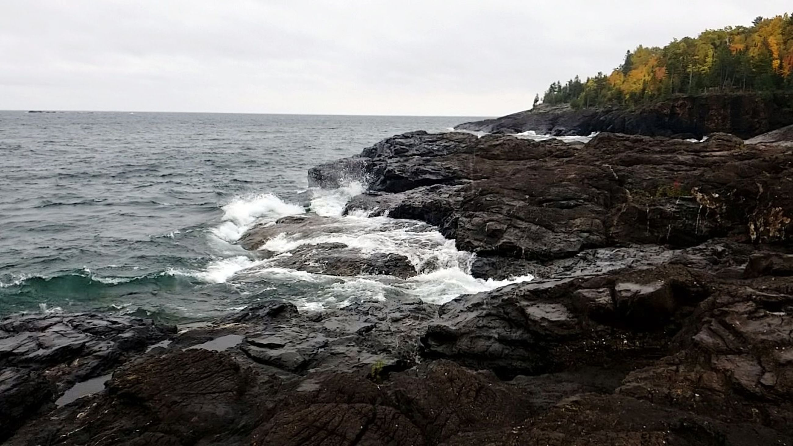 sea, water, sky, rock, beauty in nature, rock - object, scenics - nature, horizon, solid, horizon over water, motion, land, nature, rock formation, no people, wave, beach, day, tranquil scene, outdoors, power in nature, rocky coastline, breaking, hitting