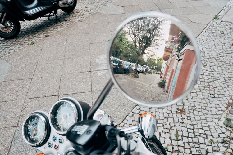 High angle view of man on side-view mirror