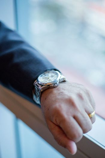 Cropped Hand Of Man Wearing Wristwatch