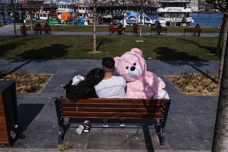 Woman relaxing on bench in city