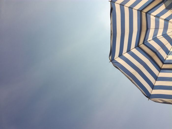 Low angle view of beach umbrella against sky