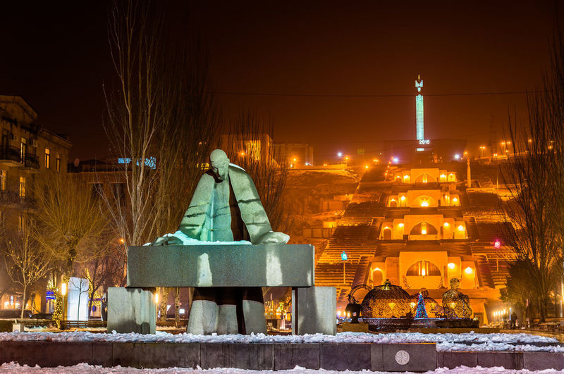 Illuminated statue of building against sky during winter at night