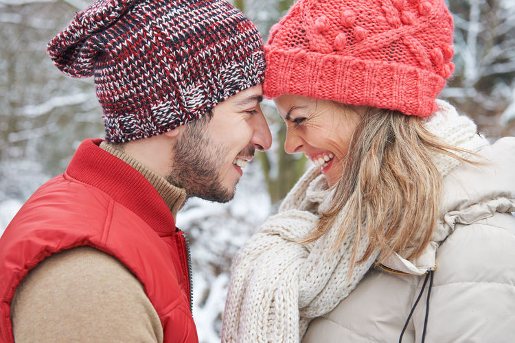 Side view of couple wearing hat