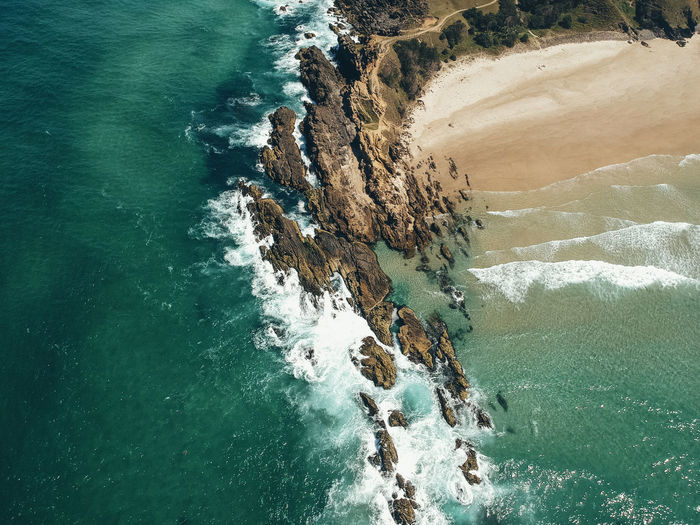 Byron Bay Water Sea Motion Beauty In Nature Rock Solid Rock - Object Nature High Angle View Rock Formation Day Scenics - Nature No People Outdoors Land Wave Tranquility Remote Turquoise Colored Power In Nature